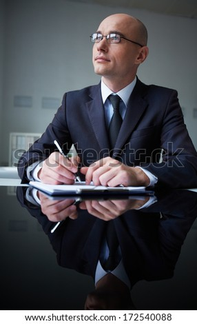 Image of pensive businessman at workplace