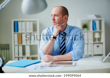 Image of pensive businessman in formalwear working in office - stock photo