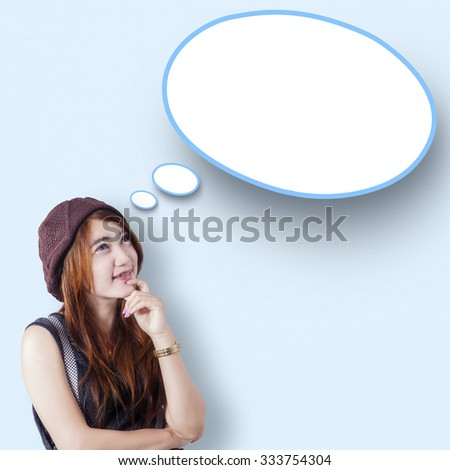Image of pensive teenage girl with casual clothes, looking at empty cloud speech