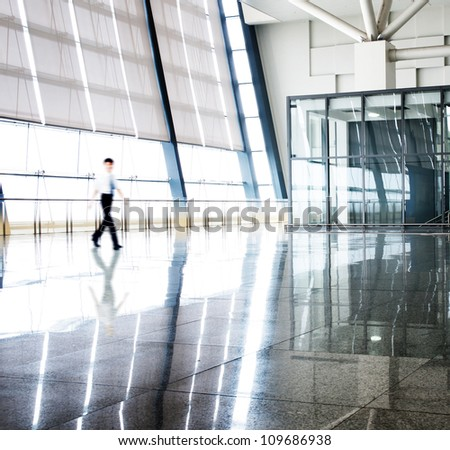 image of People silhouettes at morden office building - stock photo