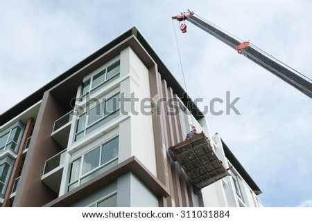 image of People work in condo on afternoon with Blue Sky - stock photo