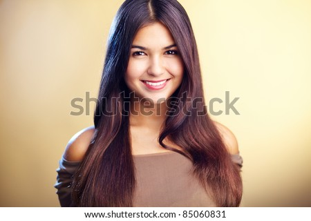Image of perfect woman looking at camera with smile