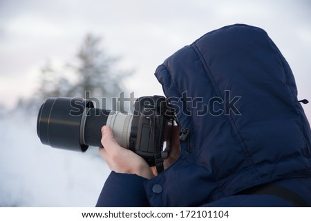Image of Photographer in winter forest