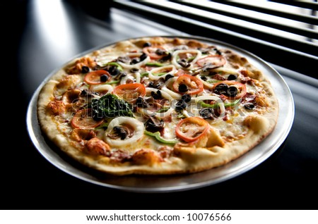 Image of pizza with sliced vegetable topping - stock photo