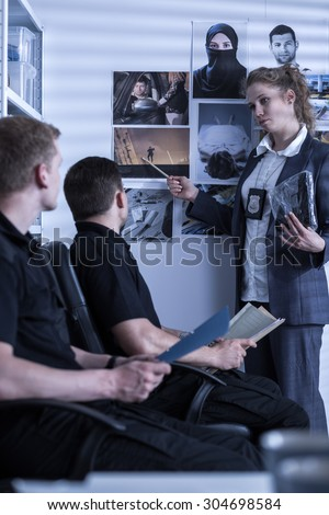 Image of policewoman presenting materials from crime scene - stock photo