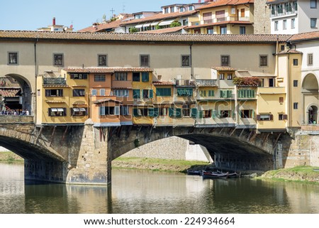 Image of Ponte Vecchio and river Arno in Florence, Italy in autumn on a sunny day - stock photo