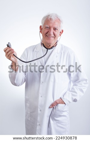 Image of practiced senior doctor with stethoscope - stock photo