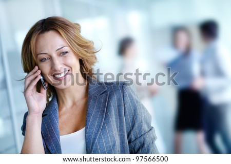 Image of pretty businesswoman calling on the phone in working environment - stock photo