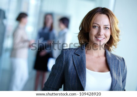 Image of pretty businesswoman looking at camera - stock photo