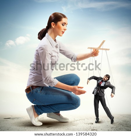 Image of pretty businesswoman puppeteer. Leadership concept - stock photo