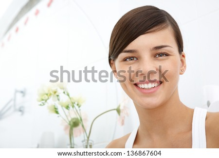 Image of pretty female looking at camera with toothy smile - stock photo