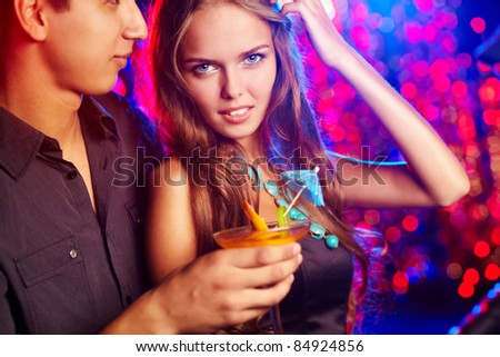 Image of pretty girl with her boyfriend in the night club