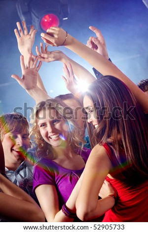 Image of pretty girls dancing with their boyfriends in night club - stock photo