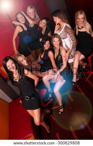 Image of pretty girls having fun in night club - stock photo