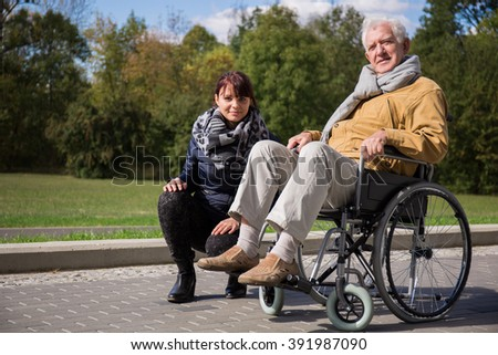 Image of private nurse and her patient with walking problem - stock photo