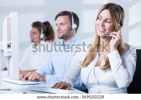 Image of professional workers of helpdesk service - stock photo