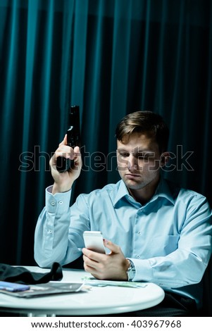 Image of psycho stalker with gun and phone - stock photo