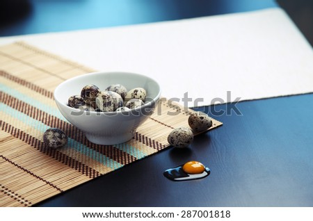 Image of quail eggs in a bowl on a table - stock photo