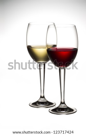 Image of red and white wine in wineglass. - stock photo