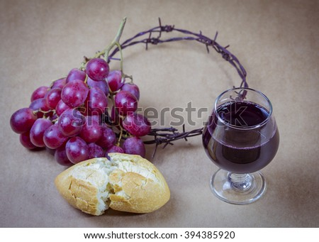 image of red grape, cup of grape juice, bread, metal Barbed Wire made like the crown of thorns  on wooden background, Communion concept, Easter background - stock photo