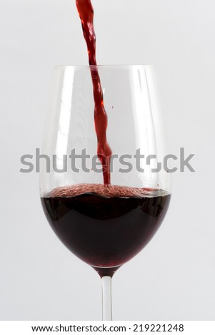 Image of red wine in the glass isolated - stock photo