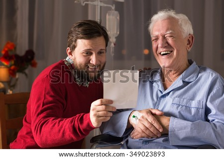 Image of relation between ill father and helpful son