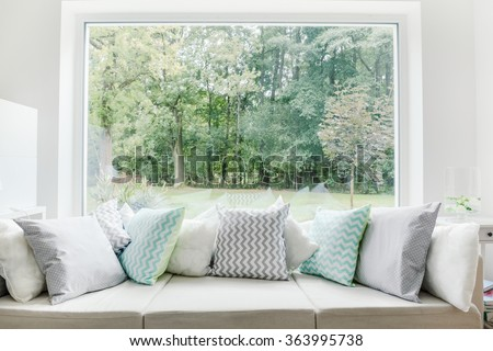 Image of relax area with large sofa and window - stock photo
