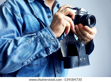 Image of reporter with film camera