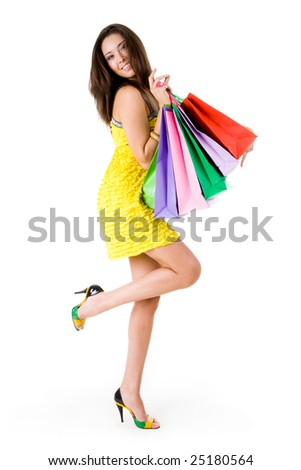 Image of rich young female with many paperbags posing before camera - stock photo