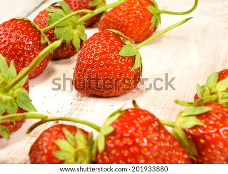image of ripe and tasty strawberries on wooden table closeup - stock photo
