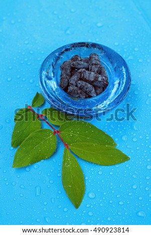 Image of ripe honeysuckle berries on wet background