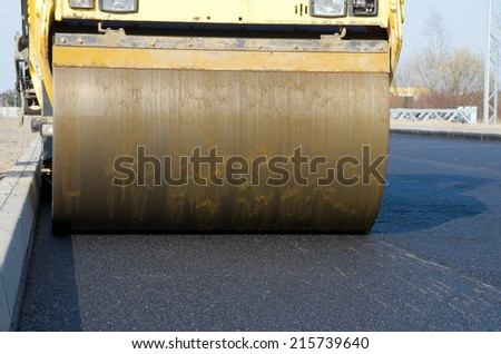 image of road roller at work - stock photo