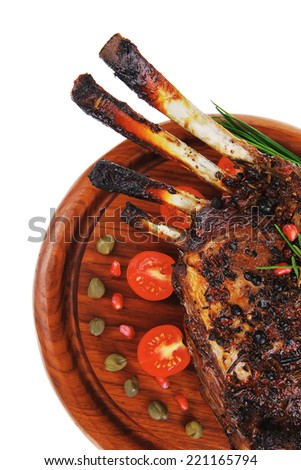 image of roasted ribs on wood over white - stock photo