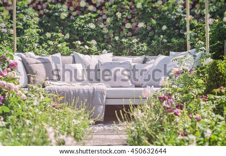 Image of romantic garden seating. Vintage filtered.  - stock photo