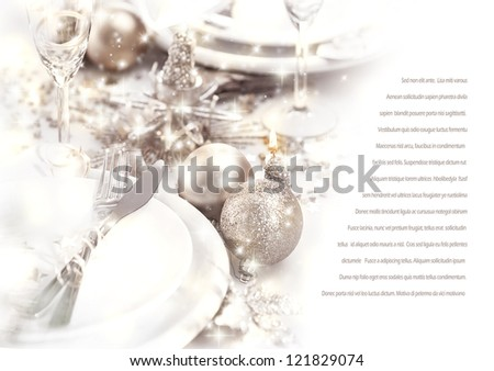 Image of romantic holiday dinner, festive table setting decorated with beautiful silver bubbles and candles, luxury white plate served with shiny knife and fork, wedding day, love story - stock photo