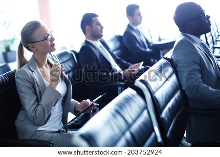 Image of row of business people attending seminar - stock photo