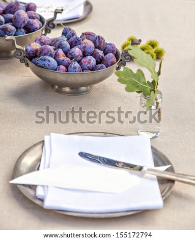 Image of rustic table setting with silverware - stock photo