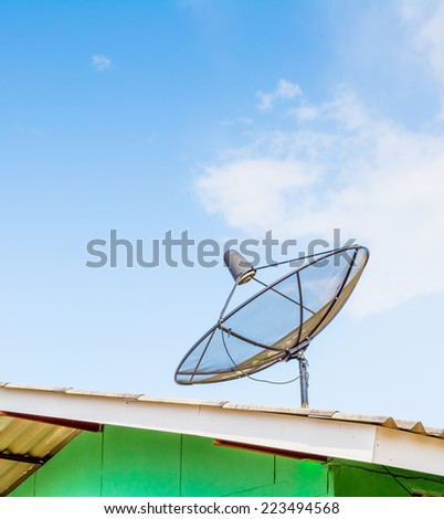image of satellite on roof with blue sky - stock photo