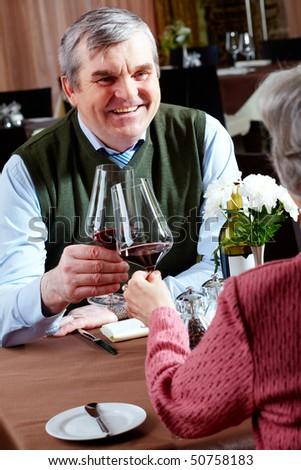 Image of senior couple having dinner at a restaurant - stock photo