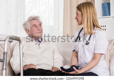 Image of senior male during medical consultation with nice doctor