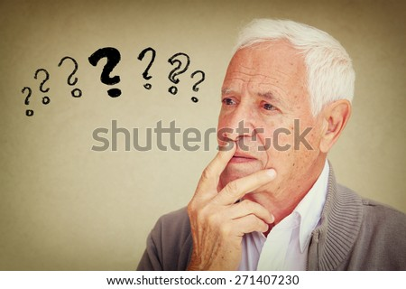 image of senior man thinking with set of question marks icons - stock photo