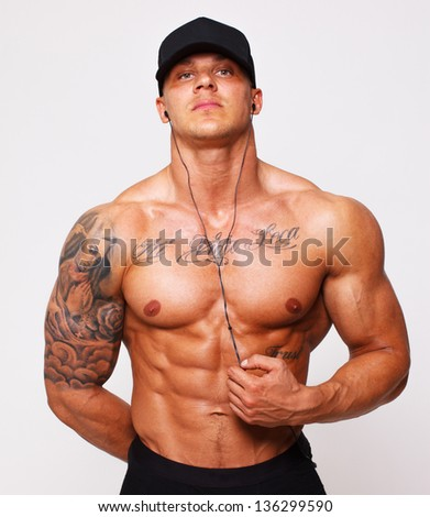 Image of serious guy in cap - stock photo