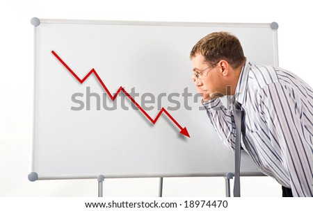 Image of serious man inclining to whiteboard and looking at recession graph on it - stock photo