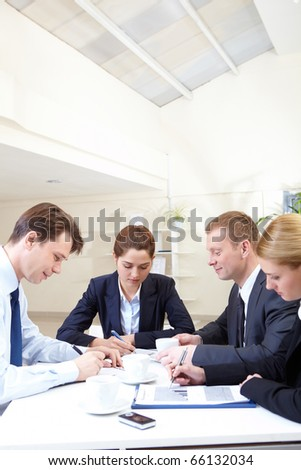 Image of several companions working with papers at meeting