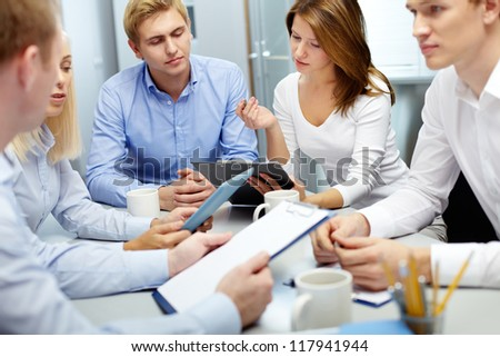 Image of several employees discussing new ideas in groups at meeting - stock photo