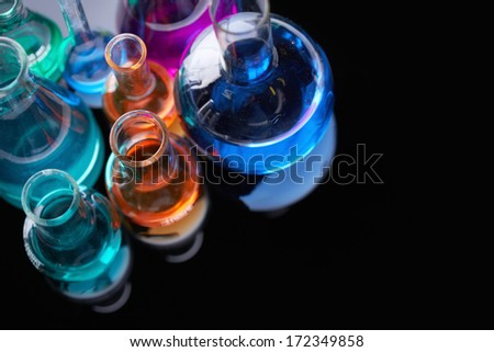 Image of several flasks with multi-color chemical liquids - stock photo