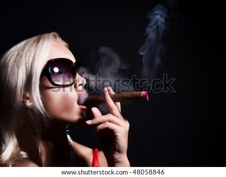 Image of sexy blonde is smoking