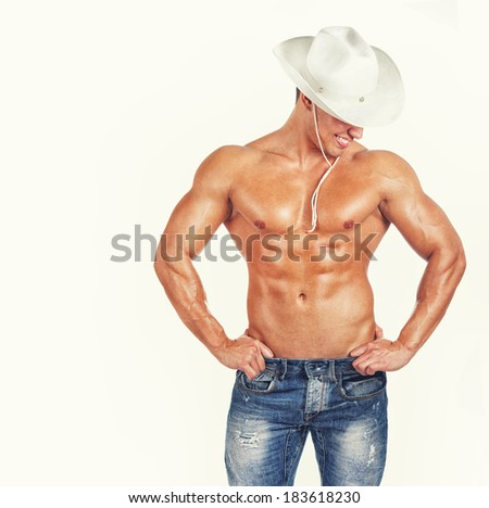 Image of sexy cowboy posing - stock photo