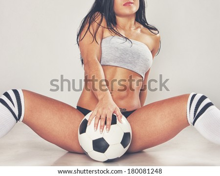 Image of sexy girl posing with ball - stock photo