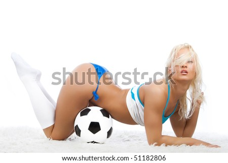 Image of sexy soccer player with ball - stock photo